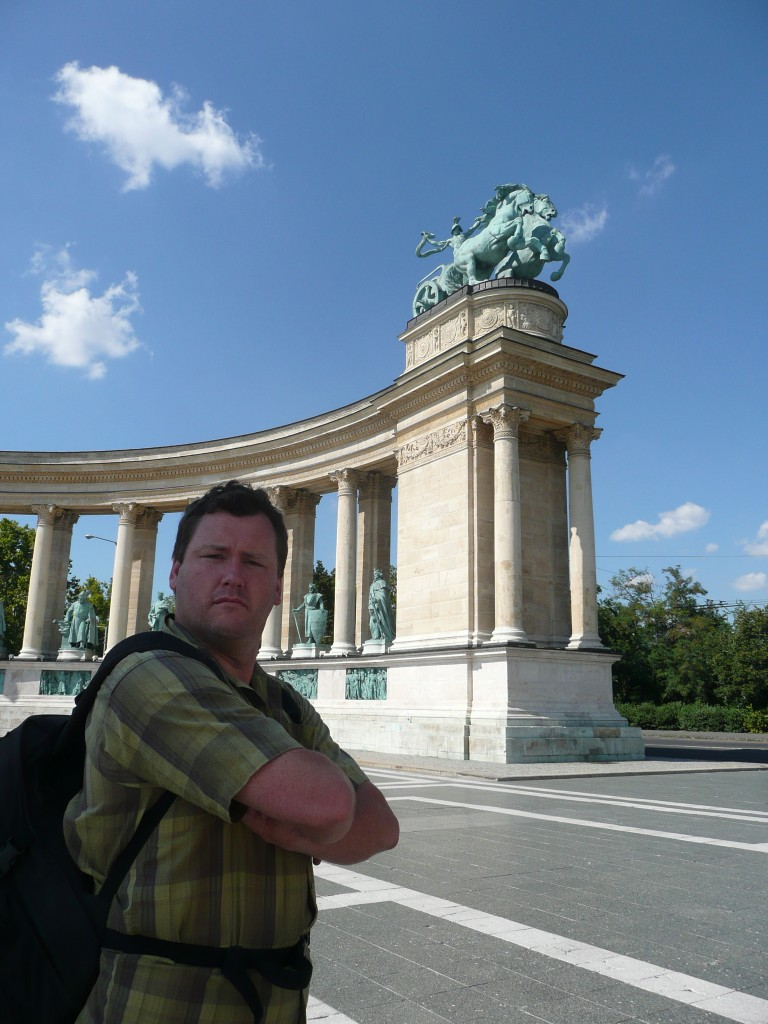 Al in front of hungary national monument,  a triumphant memorial to all the surrounding people they've slaughtered
